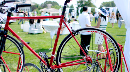 image of Party guests enjoying the glow of high performance Italian bicycles